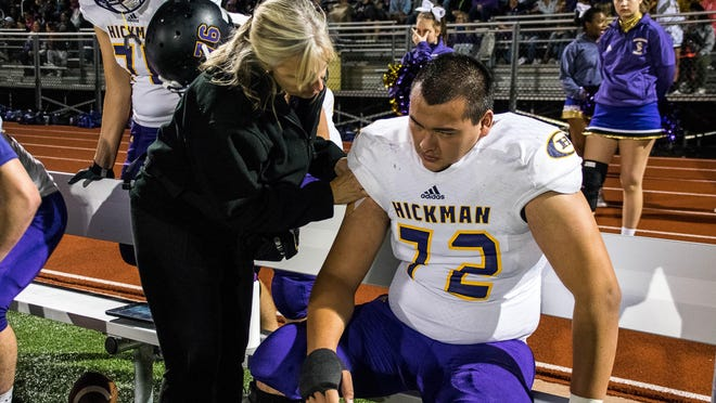 Hickman head athletic trainer Stefanie West, left, has been helping athletes at the high school since 2003. This year is unlike any other due to COVID-19.