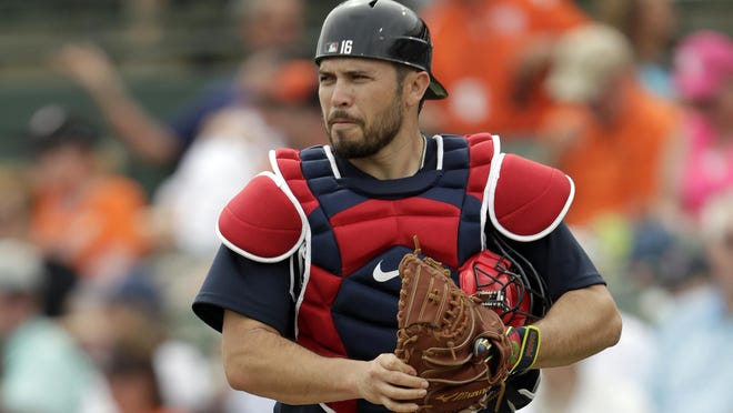 FILE - In this Feb. 26, 2020, file photo, Atlanta Braves catcher Travis d'Arnaud watches during a spring training baseball game in Sarasota, Fla. The Braves are without their top two catchers, Tyler Flowers and Travis d'Árnaud, for Friday's opening game at the New York Mets after both players showed symptoms of the coronavirus.