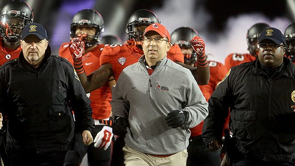 Coach Pete Lembo takes the field as Ball State hosted Northern Illinois. The Huskies won 35-21.