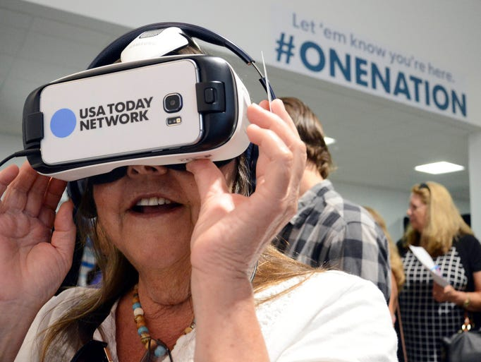 Betsy West of Merritt Island checks out a pair of virtual