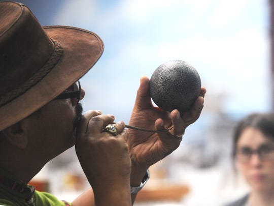 """René Corado, collections manager at the Western Foundation of Vertebrate Zoology, leads a tour and talks about an emu egg. National Public Radio's """"All Things Considered"""" recently did a segment on him."""