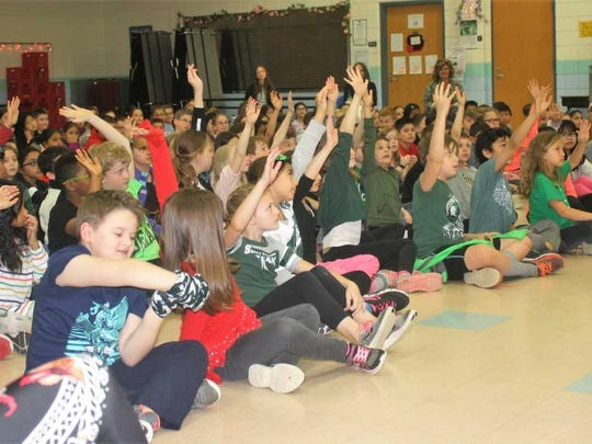 Thornton Creek students volunteer for a chance to go up on stage with Ianni.