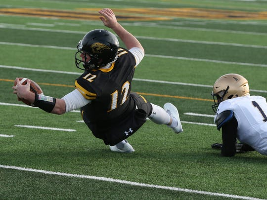 UW-Oshkosh's Brett Kasper reaches the ball toward the goal line for a touchdown in the third quarter against John Carroll University in an NCAA Division III semifinal on J.J. Keller Field at Titan Stadium.
