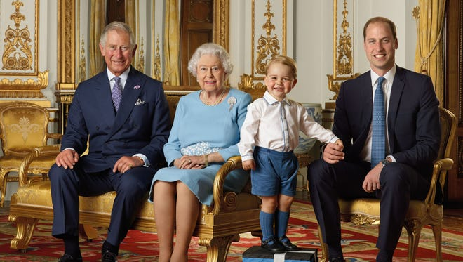 All together now: Awwwww! Another historic photo of Queen Elizabeth II and her three royal heirs, Prince Charles, Prince William and Prince George, standing on foam bricks so his head is a roughly the same level as his relatives for a picture, taken in summer of 2015,  that will be on new stamps issued in honor of the queen's 90th birthday on April 21, 2016.