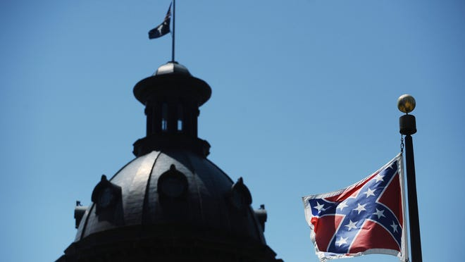 The Confederate flag flies near the South Carolina Statehouse in Columbia, S.C., on June 19, 2015. On Monday, South Carolina state senators voted Monday to remove the flag.