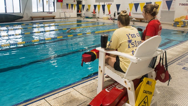 Lifeguards Kathryn Fleming, left, and Madeline Snow monitor swimmers at the Salisbury YMCA on Wednesday, Jan. 24, 2018.