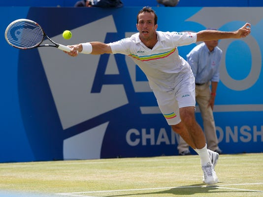 Radek Stepanek of Czech Republic plays a return to Kevin Anderson of South Africa in their Queen's Club grass court championships quarterfinal tennis match in London, Friday June 13, 2014. (AP Photo/Sang Tan)