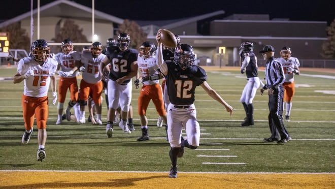 Jett Hand scores one of his three rushing touchdowns on Friday, Oct. 30 at Hillier Stadium in Augusta, Kansas. The Orioles beat ninth-seeded Ulysses 50-8 to move onto the second round of the Class 4A Playoffs.
