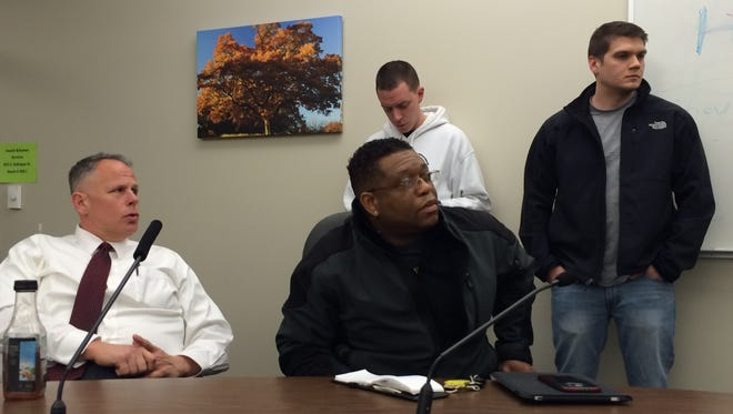 Johnson County Sheriff's Chief Deputy Steve Dolezal, left, and University of Iowa Community Outreach Officer Alton Poole, center, listen to a presentation on crisis intervention training on Wednesday at the Johnson County Health and Human Services Building.