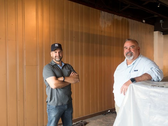 "Steve Brandon, left, and John Harbison at the construction site of the The Corner Lounge on Thursday, June 28, 2018. ""Everything that's great in my life has come from a bar,"" says Brandon. ""It's going to have bartender service,"" adds Harbison, meaning that food will be ordered from the bar. ""We'll have sandwiches and small plates."""