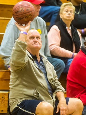 At the 2015 Governor's Challenge, Pocomoke high athletic director David Byrd plays with a basketbal while taking in a game at Wi-Hi.