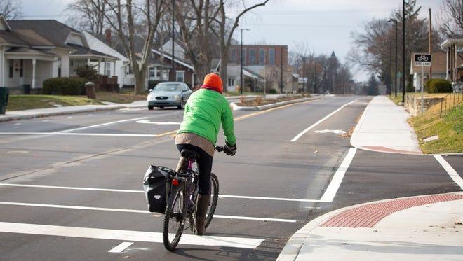 A bicyclist uses a new bike lane on Neely Avenue.