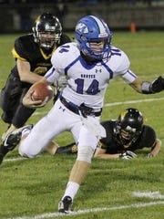 Montezuma quarterback Logan Price, 14, gains yardage