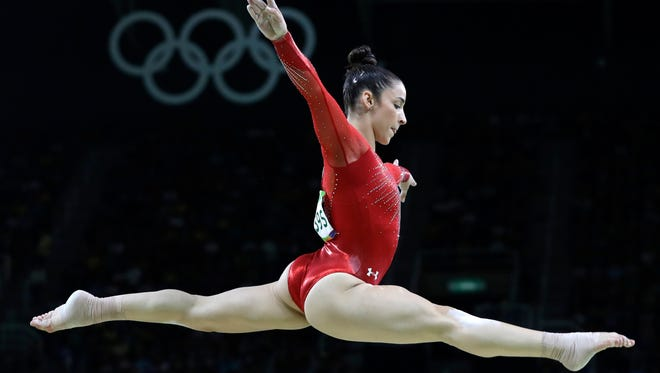Aly Raisman performs on the balance beam during the artistic gymnastics women's individual all-around final at the 2016 Summer Olympics in Rio de Janeiro, Brazil.