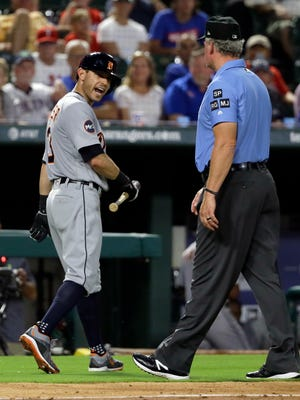 Detroit Tigers' Ian Kinsler, left, argues with crew chief Ted Barrett, right, after Kinsler was ejected by home plate umpire Angel Hernandez in the fifth inning Monday.