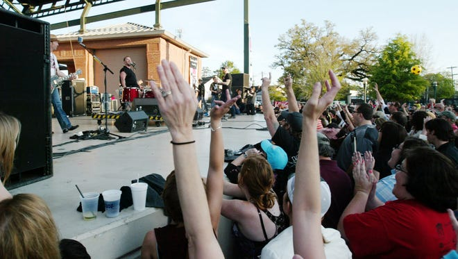 Fans cheer as Cowboy Mouth performs during  Downtown Alive! at Parc International.