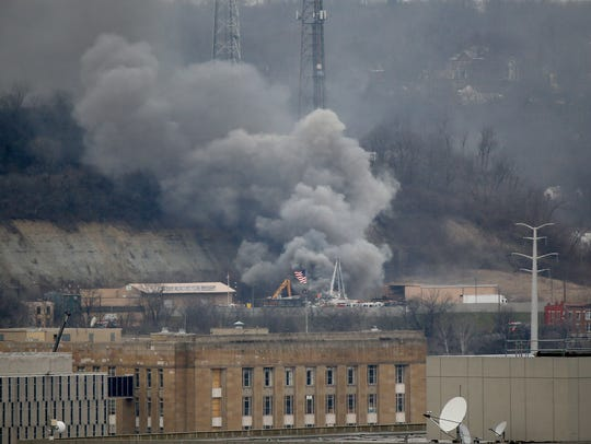 Smoke is seen from downtown at a fire at River Metals