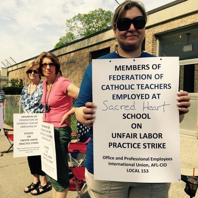 Danielle Burgio and other teachers stand outside Sacred