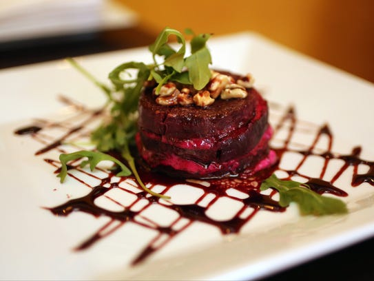 Beet Gateau: Sliced red beets layered with herbed goat