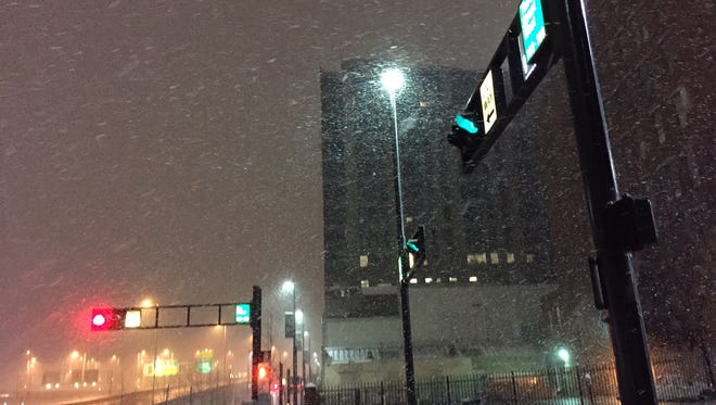 Snow comes down heavily Downtown on Third Street Monday morning.
