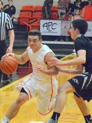Artesia junior point guard Ethan Duff dribbles down