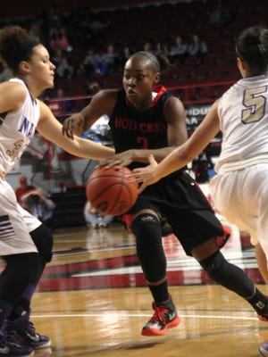 Holy Cross junior guard Dajah McClendon splits a pair of defenders. Holy Cross vs. Louisville Male. KHSAA Sweet 16 state semifinals. March 14, 2015. Western Kentucky University. E.A. Diddle Arena.