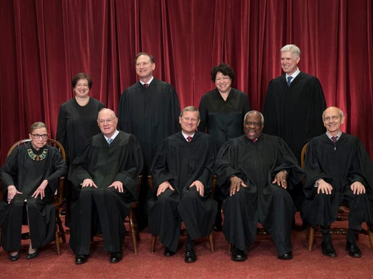 The justices of the U.S. Supreme Court gather for an