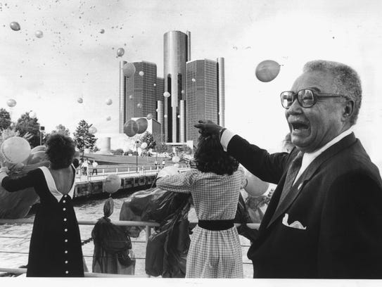 Detroit Mayor Coleman Young laughs as 1,000 balloons