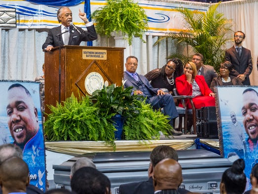 Al Sharpton speaks at the public funeral where mourners