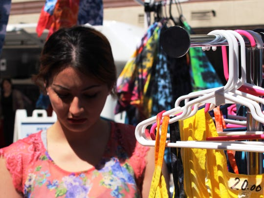 Shop for handmade and vintage items at Mainstrasse Village Bazaar on Sunday in Covington.