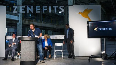 Zenefits CEO Parker Conrad speaks at a press conference in 2014. Conrad's departure in February was the beginning of a shake-up at the San Francisco-based company, which announced on Tuesday that it will eliminate about 80 jobs in Tempe.