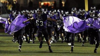 The Old Bridge High School football team takes the field for a game last season.