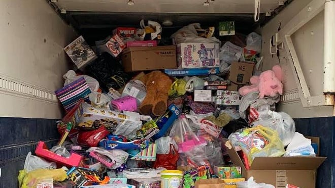 A pile of donated toys is pictured Dec. 5 inside a semitrailer. The pile of toys was collected during Michigan International Speedway's pandemic-adapted Track and Toy Drive, which was held last Saturday and featured nearly 1,600 vehicle participants. The toys were donated to the U.S. Marine Corps Reserve's Toys For Tots program in both Jackson and Lenawee counties.
