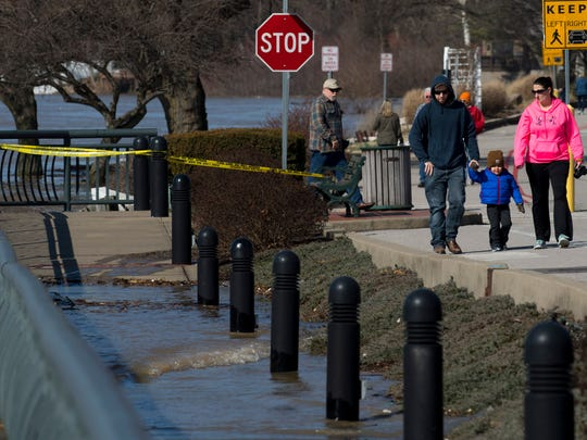 The Ohio River in Newburgh, Ind., continued to rise and was a popular place for spectators to the high water including Danny and Holly Schmidt and their 2-year-old son, Hunter, Monday morning.