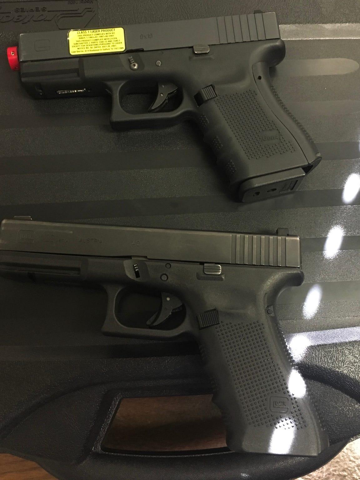 An image showing an imitation gun (top) compared to a real gun (bottom).