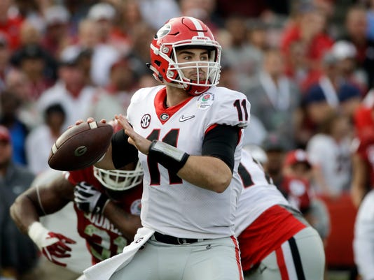 FILE- In this Monday, Jan. 1, 2018, file photo, Georgia quarterback Jake Fromm throws a pass during the Rose Bowl NCAA college football game against Oklahoma in Pasadena, Calif. Georgia plays Alabama in the Monday, Jan. 8, 2018, College Football national championship game. (AP Photo/Jae C. Hong, File)