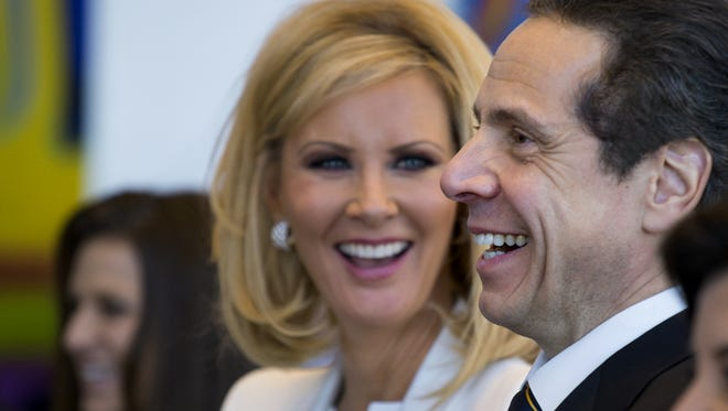 Gov. Andrew Cuomo is shown with his girlfriend, Sandra Lee, during an inaugural ceremony Jan. 1 in New York.