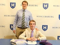Mercersburg boys lacrosse coach Michael Conklin stands with senior Tom Cremins, who signed his National Letter of Intent on Thursday, Nov. 10, 2016, to play lacrosse at Holy Cross.