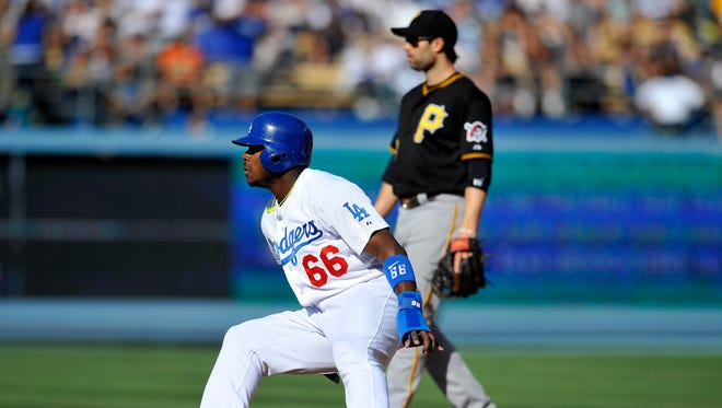 Los Angeles Dodgers right fielder Yasiel Puig (66) reaches second base in the third inning against the Pittsburgh Pirates at Dodger Stadium.
