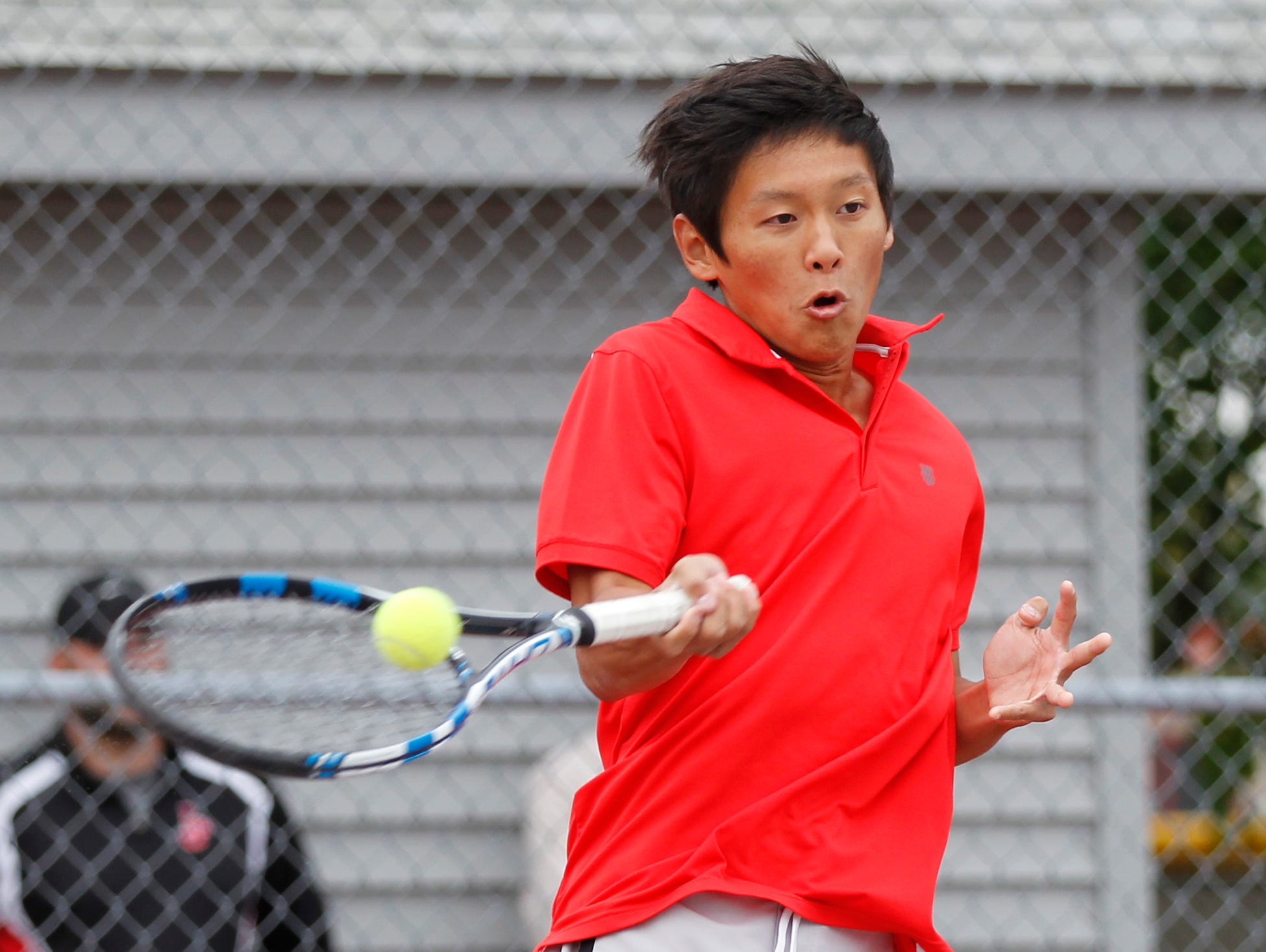 West Lafayette's Jethro Zhou with a return as he and Brian Mi take on Lafayette Jeff's Aden Beaver and Brayden Williams at No. 1 doubles during the boys tennis sectional championship Friday, October 2, 2015, at Cumberland Courts in West Lafayette.