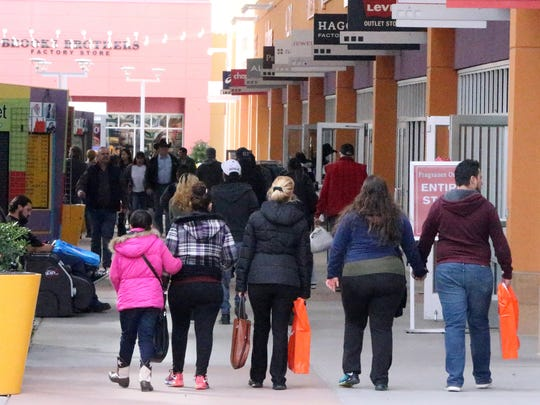 Shoppers hit the outlet stores during Black Friday at the Outlet Shoppes of El Paso in Canutillo.
