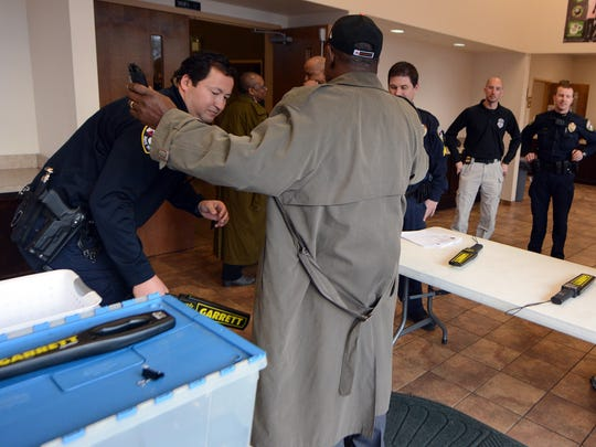 """York City Police Officer Chuck Crumpton wands a guest to the first Group Violence Intervention """"Call-In"""" at Stillmeadow Church of the Nazarene's York City campus on Chestnut St., Tuesday, Feb. 21, 2017. John A. Pavoncello photo"""