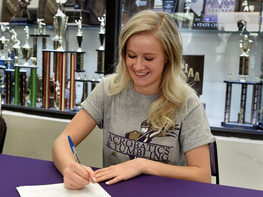Kloey Smith signed a letter of intent to attend Converse College in Spartanburg, SC for acro and tumbling on Tuesday.