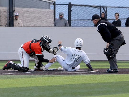 Burkburnett's Wyatt Grant tags Iowa Park's Noah Diaz for the out Friday, April 20, 2018, in Iowa Park. Grant had 36 RBIs this season and was honored as the third-team Class 4A DH on the Texas Sports Writers Association All-State team.