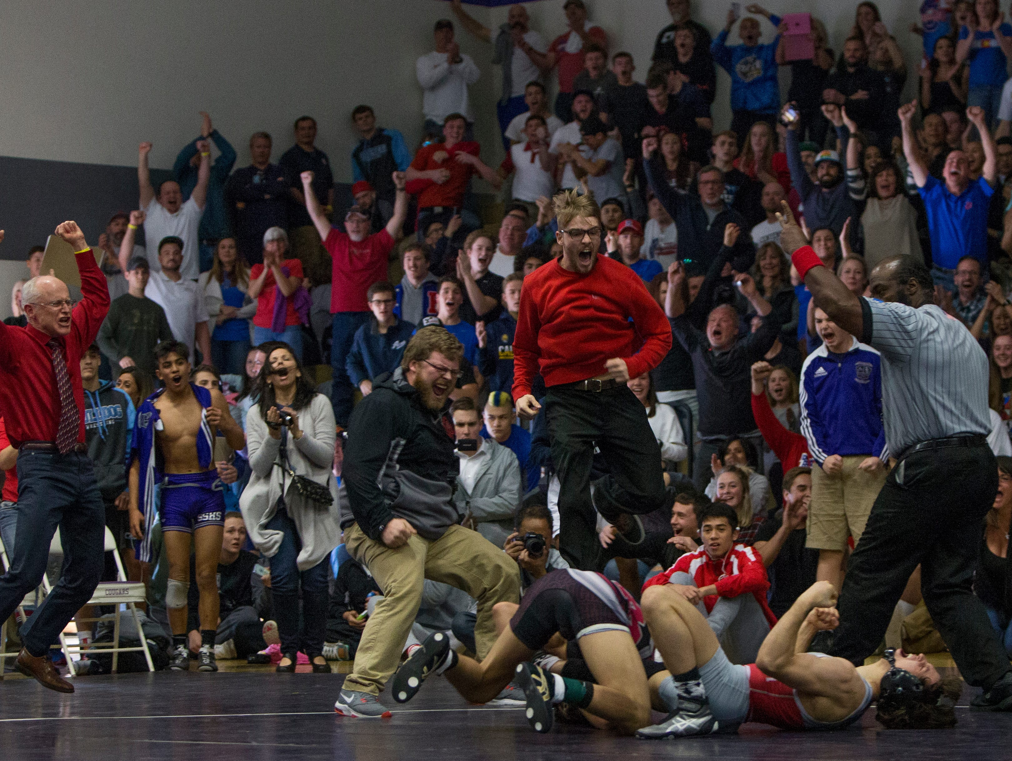 Wooster's Ian Timmins reacts laying on his back on the mat, as his coaches and fans celebrate, after defeating Cimarron's Daniel Rodriguez in the 126-pound division of the 4A Nevada State Wrestling Championships held on Saturday at Spanish Springs. Timmins won the State Championship.