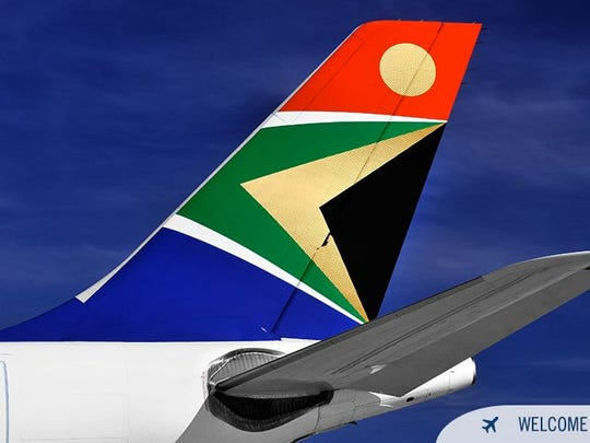 South African Airways logo is seen on the tail of one
