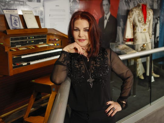 """Priscilla Presley stands in the """"60 Years of Elvis"""" exhibit inside an annex at Graceland in Memphis, Tenn."""