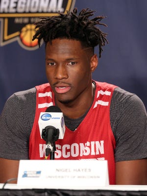Wisconsin Badgers forward Nigel Hayes (10) speaks to the media before practice the day before the East Regional semifinals of the 2017 NCAA Tournament at Madison Square Garden.