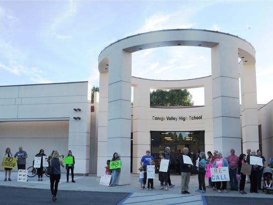 Demonstrators stand outside the Conejo Valley Unified School District offices before a regular meeting where board members were to vote on a policy directed at literature books with mature content.