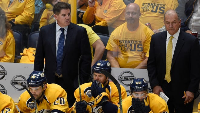 Predators head coach Peter Laviolette in the bench during the first round of the Stanley Cup Playoff at the Bridgestone Arena on Tuesday, April 19, in Nashville, Tenn.